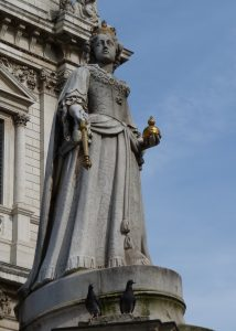 Very obliging pigeons posing with statue of Queen Anne