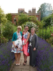 Danielle Anderton receiving her Medal for Excellence from Sue Cox, with tutor Jenny Golton